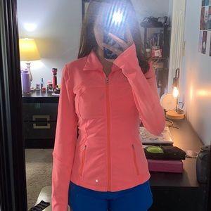 Lululemon Define Jacket in a neon peach shade